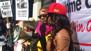 Comrade Denise speaks to the crowd at the IWWDC rally.