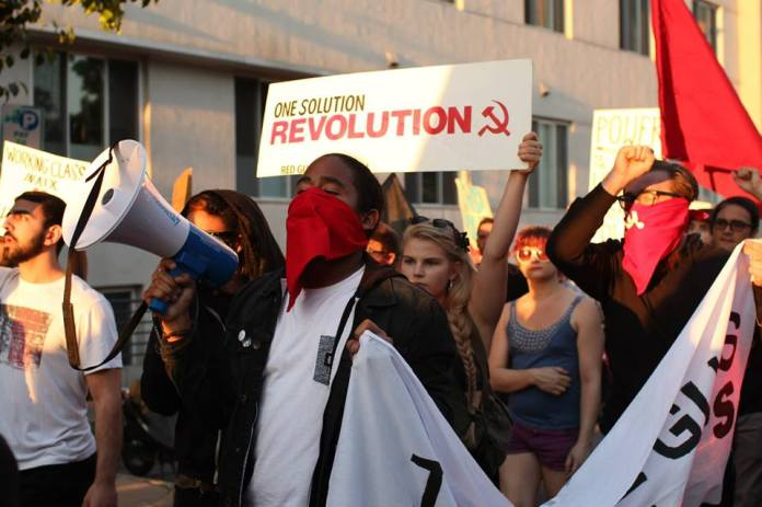 """More than 200 people chanted """"one solution—revolution!"""" and """"Baltimore, we got your back!"""""""